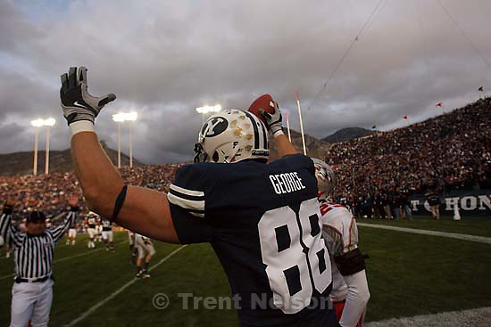 Provo - BYU TE Andrew George (88) rolls out of bounds after catching a touchdown pass ahead of New Mexico's Blake Ligon. BYU vs. New Mexico college football at LaVell Edwards Stadium, Saturday, October 11, 2008.