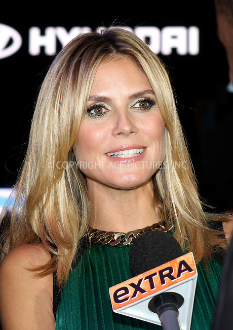 WWW.ACEPIXS.COM . . . . .  ....June 15 2012, New York City....TV personality Heidi Klum at the 10 year anniversary of Project Runway in Times Square on June 15 2012 in New York City....Please byline: NANCY RIVERA- ACEPIXS.COM.... *** ***..Ace Pictures, Inc:  ..Tel: 646 769 0430..e-mail: info@acepixs.com..web: http://www.acepixs.com