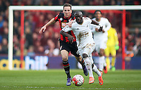 Modou Barrow of Swansea City and Dan Gosling of Bournemouth during the Barclays Premier League match between AFC Bournemouth and Swansea City played at The Vitality Stadium, Bournemouth on March 11th 2016
