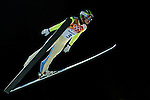 Heung-Chul Choi of Korea jumps during the Men's Normal Hill Individual of the 2014 Sochi Olympic Winter Games at Russki Gorki Ski Juming Center on February 9, 2014 in Sochi, Russia. Photo by Victor Fraile / Power Sport Images