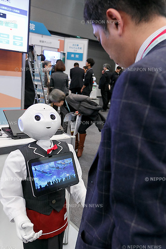 A visitor looks at a humanoid robot Pepper on display during SoftBank Robot World 2017 on November 21, 2017, Tokyo, Japan. SoftBank Robotics organized SoftBank Robot World 2017 to introduce AI (Artificial Intelligence) and IoT (the Internet of Things) companies developing the latest technology for robots, including applications its humanoid robot Pepper in various business fields. The robot expo runs until November 22. (Photo by Rodrigo Reyes Marin/AFLO)