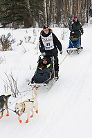 Ed Steilstra w/Iditarider on Trail 2005 Iditarod Ceremonial Start near Campbell Airstrip Alaska SC
