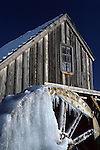 Frozen water wheel in winter sunrise Mill Creek Snohomish County Washington State USA.