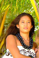 Young woman with kukui nut lei
