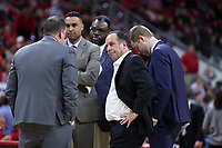 RALEIGH, NC - JANUARY 9: Head coach Mike Brey of the University of Notre Dame huddles with his assistants during a game between Notre Dame and NC State at PNC Arena on January 9, 2020 in Raleigh, North Carolina.