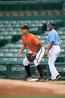 Baltimore Orioles first baseman Juan Escarra (46) waits for a throw as first base coach Gary Redus looks on during an Instructional League game against the Tampa Bay Rays on October 5, 2017 at Ed Smith Stadium in Sarasota, Florida.  (Mike Janes/Four Seam Images)