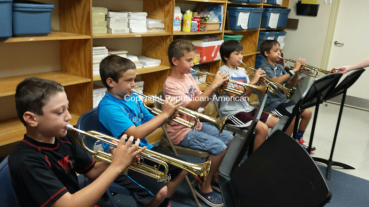 MIDDLEBURY, CT --- 09 Sept. 2014: 090914BB01 --- Middlebury Elementary School fifth graders learn to play the trumpet. According to school policy, only first names can be used. From left is Mason, Michael, Ian, Boe and Aidan. Students interested in joining the school band should email Director Elizabeth Del Vecchio at edelvecchio@region15.org. Bill Bittar Republican-American