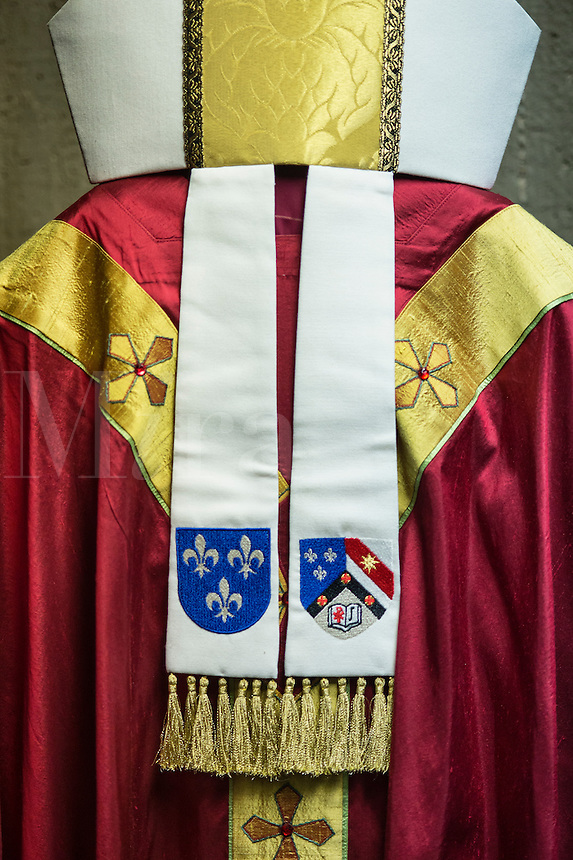 Chasuble and mitre worn by an abbot  during the celebration of catholic mass.