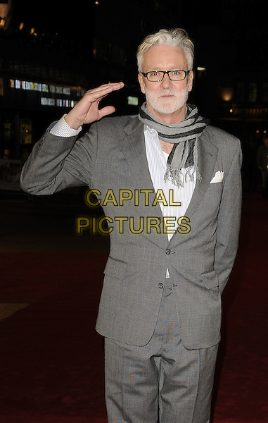 "JOHN HART.The UK Film Premiere of ""Revolutionary Road"" at the Odeon Leicester Square, London, England..January 18th 2009.half 3/4 length grey gray hand salute gesture scarf suit beard facial hair producer.CAP/CAN.©Can Nguyen/Capital Pictures."