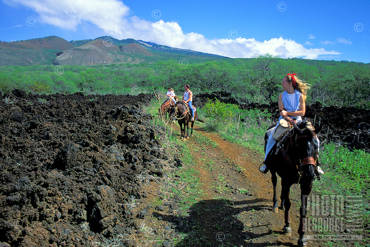 Horseback riders on a Makena Stables outing follow trail by hardened lava dating from Haleakala's last eruption