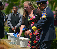 May 10, 2013  (Washington, DC)  Baltimore Police Commissioner Anthony Batts dedicates a flower to fallen officers during a ceremony at the Washington Area Law Enforcement Memorial.  (Photo by Don Baxter/Media Images International)