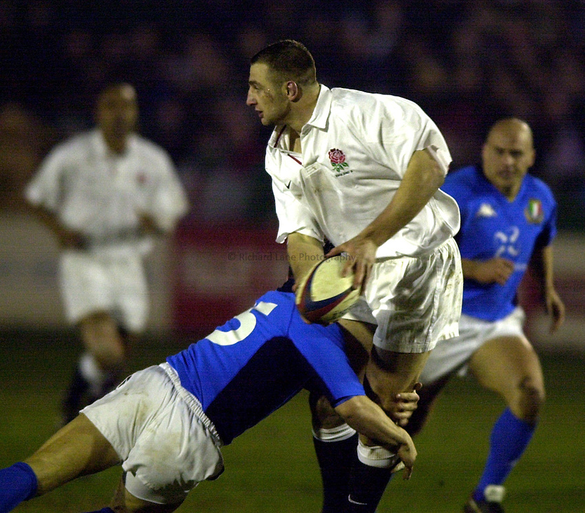 Photo. Richard Lane. .England A v Italy A at Goldington Road, Bedford. 16/2/2001.Steve Borthwick offloads the ball in the tackle.