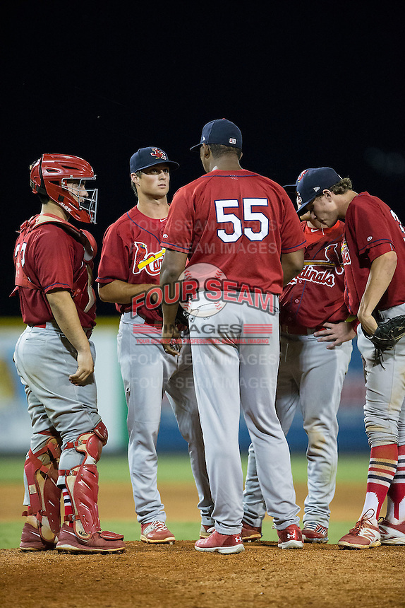 Johnson City Cardinals pitching coach Bill Villanueva (55) has a chat on the mound with relief pitcher Chandler Hawkins (38) during the game against the Burlington Royals at Burlington Athletic Park on August 22, 2015 in Burlington, North Carolina.  The Cardinals defeated the Royals 9-3. (Brian Westerholt/Four Seam Images)
