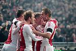 Nederland, Amsterdam, 20 januari 2013.Eredivisie.Seizoen 2012-2013.Ajax-Feyenoord.Viktor Fischer wordt omhelst door zijn medespelers. V.l.n.r.: Derk Boerrigter, Christian Eriksen, Viktor Fischer, Lasse Schone en Siem de Jong, aanvoerder van Ajax.