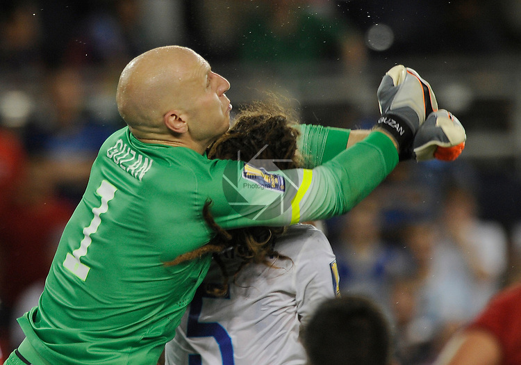 USA Brad Guzan (1) prepares to deflect a shot on goal and in the process reaches around the head of teammate USA Kyle Beckerman (5). Panama tied the USA 1-1 in a Group A game during the Gold Cup 2015 at Sporting Park in Kansas City, Kansas on Monday July 13, 2015.