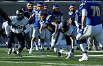BROOKINGS, SD - DECEMBER 9: Brady Mengarelli #44 from South Dakota State University tries to slip the grasp of Jared Kuehl #58 from the University of New Hampshire during their FCS quarterfinal game Saturday afternoon at Dana J. Dykhouse Stadium in Brookings, SD. (Photo by Dave Eggen/Inertia)
