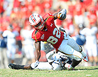 Torrey Smith of the Terrapins is brought down by an FIU defender.  Maryland defeated FIU 42-28 during a game at Capital One Field at Byrd Stadium in College Park, MD on Saturday, September 25, 2010. Alan P. Santos/DC Sports Box