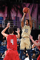 MIAMI, FL - DECEMBER 22:  FIU Forward Hassan Hussein (10) shoots a jump shot over Hartford forward George Blagojevic (4) in the second half as the University of Hartford Hawks defeated the FIU Golden Panthers, 79-72, on December 22, 2017, at Ocean Bank Convocation Center in Miami, Florida.