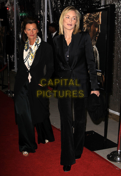 "SHARON STONE .""Crazy Heart"" - Los Angeles Premieres held Academy of Motion Picture Arts and Sciences, Beverly Hills, California, USA..December 8th, 2009.full length black suit trouser clutch bag trousers blazer .CAP/ADM/KB.©Kevan Brooks/AdMedia/Capital Pictures."