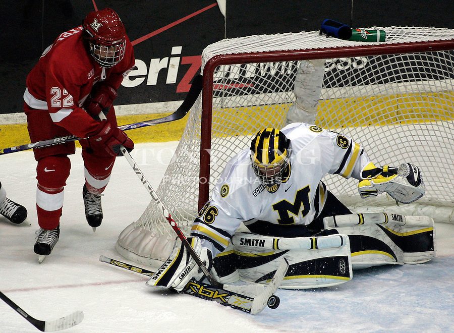 19 October 2006: Michigan goaltender Billy Sauer (36) blocks the puck from being swept in goal by Miami forward Nino Musitelli (22) during Michigan's 6-3 win in their CCHA season opener against Miami (OH) at Yost Ice Arena in Ann Arbor, MI.