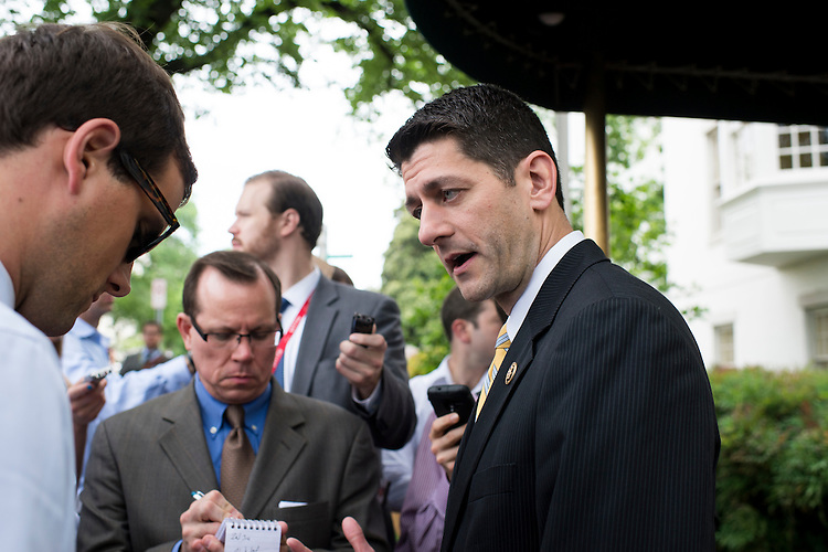UNITED STATES - MAY 19: Rep. Paul Ryan, R-Wisc., speaks to reporters as he leaves the House Republican Conference meeting at the Capitol Hill Club in Washington on Tuesday, May 19, 2015. (Photo By Bill Clark/CQ Roll Call)