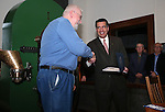 Nevada Gov. Brian Sandoval congratulates Nevada State Museum Curator Bob Nylen for his years of services during a ceremony marking the beginning of production of the second design in a four-part series of Sesquicentennial medallions at the Nevada State Museum, in Carson City, Nev., on Wednesday, Feb. 26, 2014. <br /> Photo by Cathleen Allison/Nevada Photo Source