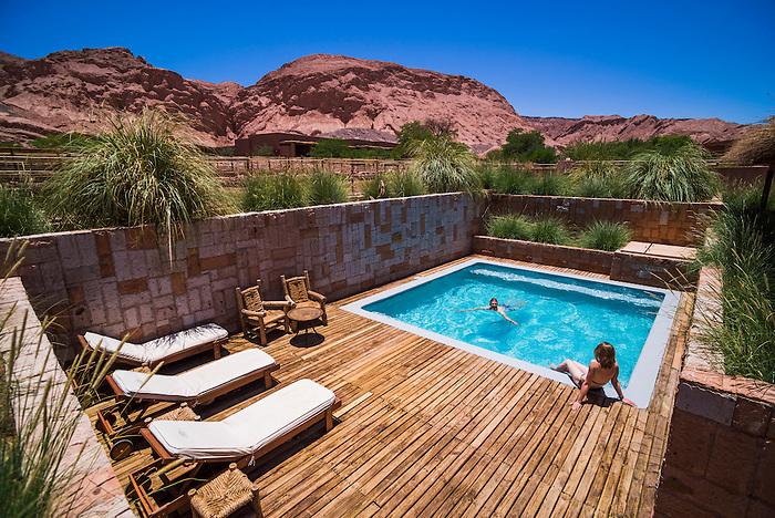 Couple at a private swimming pool at Hotel Alto Atacama Desert Lodge and Spa, San Pedro de Atacama, Atacama Desert, Chile