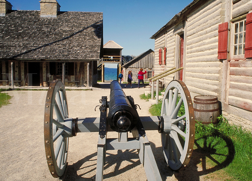 historic canon and buildings at colonial Fort Michilimackinac, MI. Mackinaw City Michigan USA.