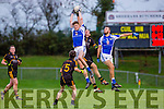 Josh Holland Templenoe makes a spectacular catch over Noel Meaney Coolmeen during the Munster Junior Championship final in Mallow on Sunday