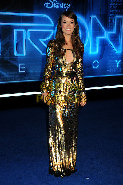 "OLIVIA WILDE .""TRON: Legacy"" L.A. Premiere held at the El Capitan Theatre, Hollywood, California, USA, 11th December 2010..full length clutch bag shiny gold cut out sequined sequin dress long sleeve maxi .CAP/ADM/BP.©Byron Purvis/AdMedia/Capital Pictures."