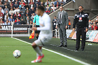 Swansea City manager Paul Clement and Huddersfield Town manager David Wagner watch on as Martin Olsson of Swansea City receives the ball during the Premier League match between Swansea City and Huddersfield Town at The Liberty Stadium, Swansea, Wales, UK. Saturday 16 October 2017
