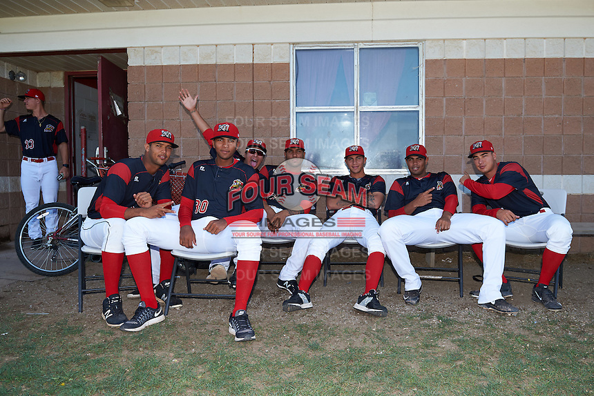 Batavia Muckdogs pitchers Aneury Osaria, Humberto Mejia, Javier Garcia, Victor Delgado, Geral Silva, Jose Diaz, Ty Provencher before the second game of a doubleheader against the Auburn Doubledays on September 4, 2016 at Dwyer Stadium in Batavia, New York.  Shane Sawczak (33) is in the doorway.  Batavia defeated Auburn 6-5. (Mike Janes/Four Seam Images)