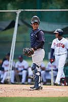 GCL Yankees West catcher Hemmanuel Rosario (21) looks into the dugout during the second game of a doubleheader against the GCL Braves on July 30, 2018 at Champion Stadium in Kissimmee, Florida.  GCL Braves defeated GCL Yankees West 5-4.  (Mike Janes/Four Seam Images)