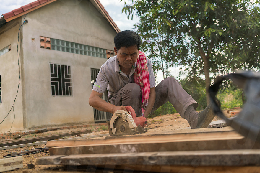 November 27, 2016 - Pailin (Cambodia). Touch Sokhan works in the courtyard of his house. Touch is a former Khmer Rouge cadre from Kampot and he is now chief of O' Tapuk Krom's village in Pailin. He lost a leg stepping on a landmine and converted to Christian thanks to his daughter. © Thomas Cristofoletti / Ruom