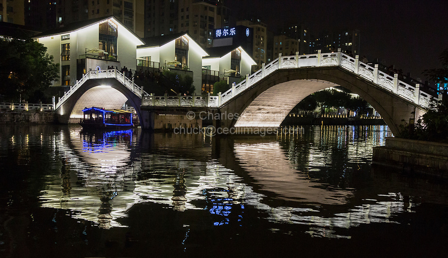 Wenzhou, Zhejiang, China.  Tourist Boat Passing under Bridge Over the Nantong River, at Night.