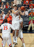 CHARLOTTESVILLE, VA- December 27: Joe Harris #12 of the Virginia Cavaliers grabs a rebound during the game against the Maryland-Eastern Shore Hawks on December 27, 2011 at the John Paul Jones Arena in Charlottesville, Va. Virginia defeated Maryland Eastern Shore 69-42.  (Photo by Andrew Shurtleff/Getty Images) *** Local Caption *** Joe Harris