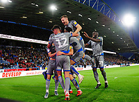 Lincoln City's Harry Anderson (hidden) celebrates scoring the opening goal with team-mates<br /> <br /> Photographer Chris Vaughan/CameraSport<br /> <br /> The Carabao Cup First Round - Huddersfield Town v Lincoln City - Tuesday 13th August 2019 - John Smith's Stadium - Huddersfield<br />  <br /> World Copyright © 2019 CameraSport. All rights reserved. 43 Linden Ave. Countesthorpe. Leicester. England. LE8 5PG - Tel: +44 (0) 116 277 4147 - admin@camerasport.com - www.camerasport.com