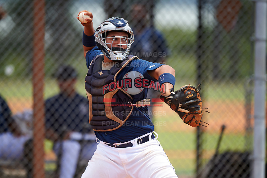 GCL Tigers East catcher Elys Escobar (22) throws down in between innings during a game against the GCL Tigers West on August 4, 2016 at Tigertown in Lakeland, Florida.  GCL Tigers West defeated GCL Tigers East 7-3.  (Mike Janes/Four Seam Images)