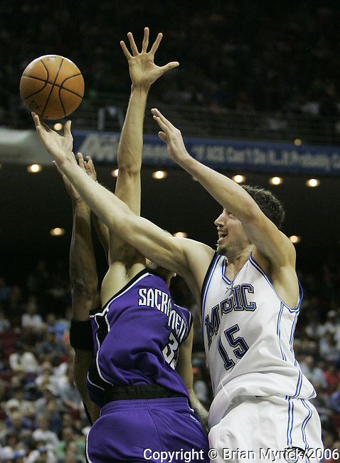 The Orlando Magic's Hedo Turkoglu (15), of Turkey, shoots past the Sacramento King's Francisco Garcia (32) during their NBA basketball game at the T.D.Waterhouse Center in Orlando, Fla., Saturday, January 21, 2006.  The Magic defeated the Kings in overtime with a score of 83-78 giving Orlando their sixth consecutive win at home.(AP Photo/Brian Myrick)