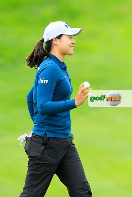 In Gee Chun (KOR) sinks her putt on the 13th green during Saturday's Round 3 of The 2016 Evian Championship held at Evian Resort Golf Club, Evian-les-Bains, France. 17th September 2016.<br /> Picture: Eoin Clarke   Golffile<br /> <br /> <br /> All photos usage must carry mandatory copyright credit (&copy; Golffile   Eoin Clarke)