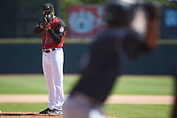 Hickory Crawdads starting pitcher Yerry Rodriguez (30) looks to his catcher for the sign against the Charleston RiverDogs at L.P. Frans Stadium on May 13, 2019 in Hickory, North Carolina. The Crawdads defeated the RiverDogs 7-5. (Brian Westerholt/Four Seam Images)