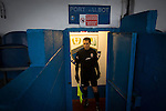 Port Talbot Town 3 Caerau Ely 0, 06/02/2016. Genquip Stadium, Welsh Cup fourth round. A referee's assistant waiting for the teams in the tunnel area before Port Talbot Town played host to Caerau Ely in a Welsh Cup fourth round tie at the Genquip Stadium, formerly known as Victoria Road. Formed by exiled Scots in 1901 as Port Talbot Athletic, they competed in local and regional football before being promoted to the League of Wales  in 2000 and changing their name to the current version a year later. Town won this tie 3-0 against their opponents from the Welsh League, one level below the welsh Premier League where Port Talbot competed, watched by a crowd of 113. Photo by Colin McPherson.