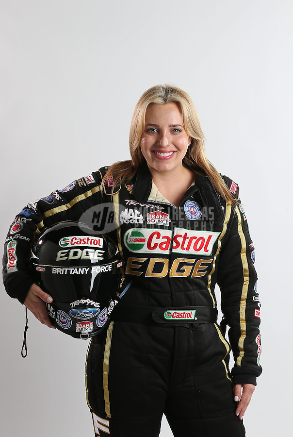 Feb. 22, 2013; Chandler, AZ, USA; NHRA top fuel dragster driver Brittany Force poses for a portrait prior to qualifying for the Arizona Nationals at Firebird International Raceway. Mandatory Credit: Mark J. Rebilas-