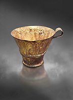 Mycenaean gold cup with arches decoration, Grave V, Grave Circle A Mycenae, Greece. National Archaeological Museum of Athens.  Grey Art Background<br /> <br /> An elegant precious gold cup hammered from thick gold to created a simple elegant design. This Mycenaean gold cup demonstrates how advance Mycenaean metalworking was in the 16th century BC. The value of the cup would have been extermely high so must have graced the table of a Mycenaean noble perhaps even a v king.