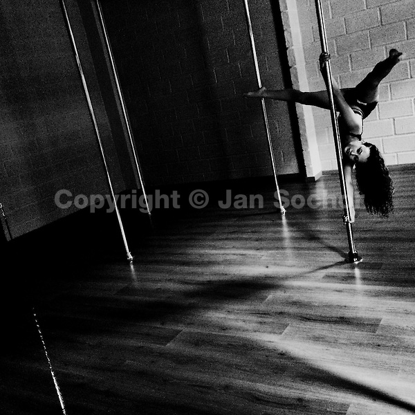 Carolina Echavarria, a young Colombian pole dancer, performs during a pole dance training session at Academia Pin Up, a dance studio in Medellín, Colombia, 2 March 2016.