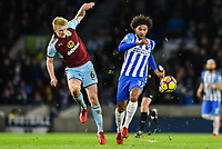 Isaiah Brown of Brighton & Hove Albion (37) and Ben Mee of Burnley (6) challenge for the ball   during the EPL - Premier League match between Brighton and Hove Albion and Burnley at the American Express Community Stadium, Brighton and Hove, England on 16 December 2017. Photo by Edward Thomas / PRiME Media Images.