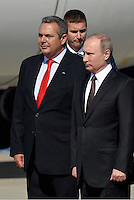 Pictured: Vladimir Putin (R) with Panayiotis Kamenos during his arrival to Athens Friday 27 May 2016<br /> Re: Russian President Vladimir Putin arrives at Eleftherios Venizelos Airport near Athens, Greece
