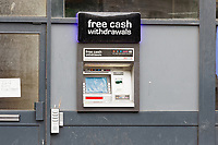 "Pictured: The cash machine at the Station Cabs office on the High Street, Swansea, Wales, UK. Friday 12 July 2019<br /> Re: A company which installs cash machines, has been ordered to remove one of its ATMs because it is a few inches out of place although two adjacent shops have similar cash machines installed. <br /> Notemachine UK Ltd had offered to move the cash machine to the right if its planning appeal was allowed.<br /> But Aidan McCooey, a planning inspector appointed by the Welsh Government said that the ATM should have been installed in the centre of the shopfront of the Station Cabs Office in the High Street, Swansea, UK.<br /> The inspector also found that the ""free cash withdrawals at the top partially obscured the window above"".<br /> The company had initially appealed to Swansea Council who found that it contravened planning guidance by being slightly askew, and that it detracted from the look of High Street which is plagued by antisocial behaviour, drugs and prostitution.<br /> Mr McCooey said: ""The development is detrimental to the design and integrity of the shopfront"".<br /> ""It therefore has an adverse effect on the character and appearance of this building, and the street"" he added.<br /> A spokesman for the company confirmed that the ATM will be removed."