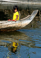 The Images from the Book Journey through Color and Time, 2006, Cambodia, A child in a traditional boat on Tonle Sap lake water village