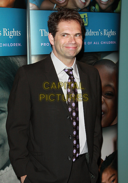 "DANA GOULD.Alliance For Children's Rights ""Right To Laugh"" Fundraiser  held at the Catalina Jazz Club, Hollywood, California, USA..March 15th, 2010.half length black suit jacket purple tie .CAP/ADM/TC.©T. Conrad/AdMedia/Capital Pictures."